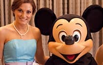 A bridesmaid poses with Mickey Mouse