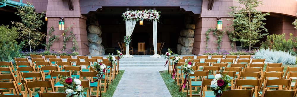 Chairs arranged on lawn facing an altar