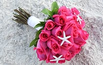 A rose bouquet adorned with starfish charms