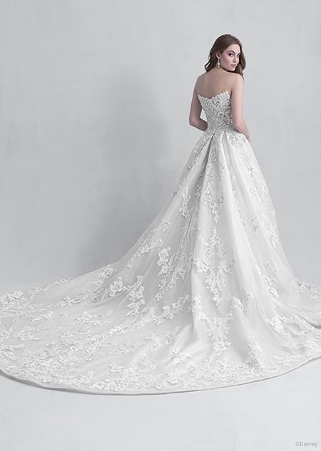 A back side view of a woman wearing the Aurora wedding gown from the 2021 Disney Fairy Tale Weddings Platinum Collection