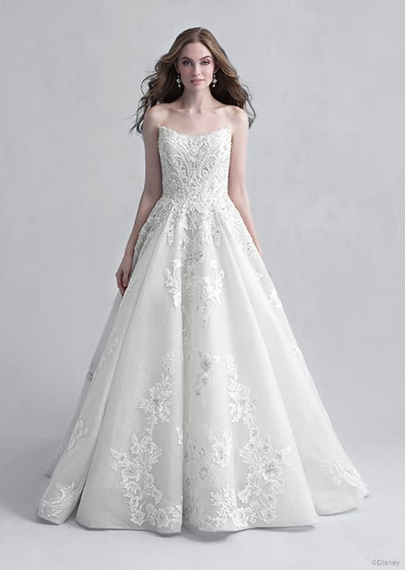 A woman wearing the Aurora wedding gown from the 2021 Disney Fairy Tale Weddings Platinum Collection
