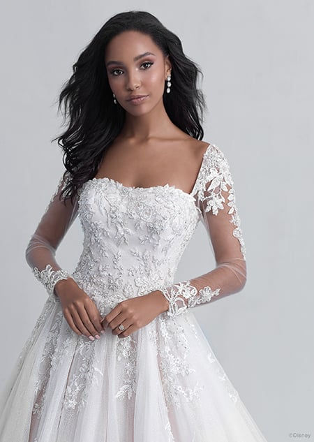 A woman in the Belle wedding gown from the 2021 Disney Fairy Tale Weddings Platinum Collection
