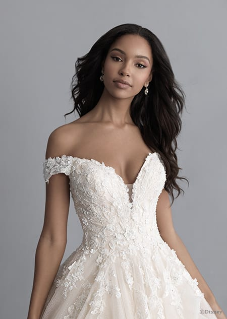 A woman in the Belle wedding gown from the 2020 Disney Fairy Tale Weddings Platinum Collection