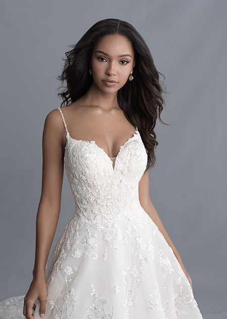 A woman dressed in the Tiana wedding gown from the 2020 Disney Fairy Tale Weddings Platinum Collection