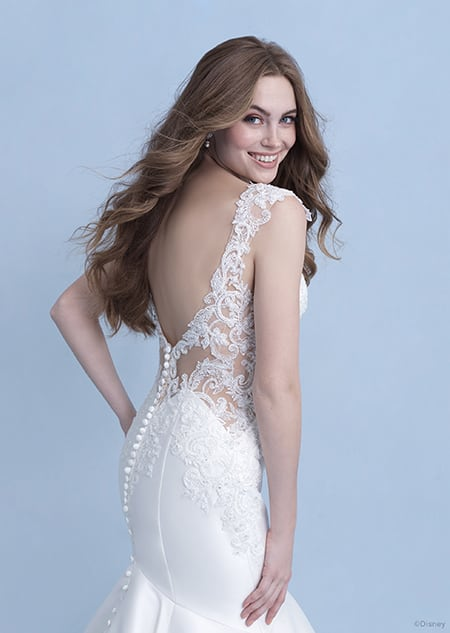 A woman wearing the Ariel wedding gown from the 2021 Disney Fairy Tale Weddings Collection