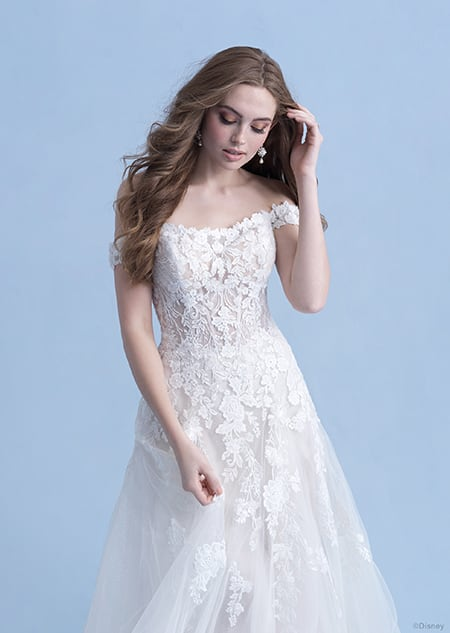 A side view of a woman in the Aurora wedding gown from the 2021 Disney Fairy Tale Weddings Collection