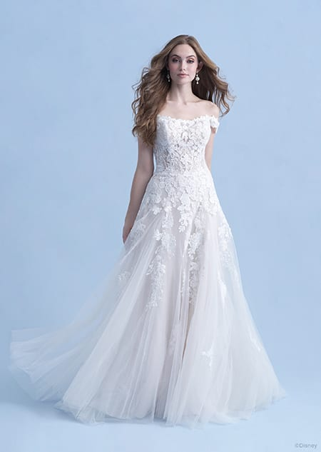 A woman dressed in the Aurora wedding gown from the 2021 Disney Fairy Tale Weddings Collection