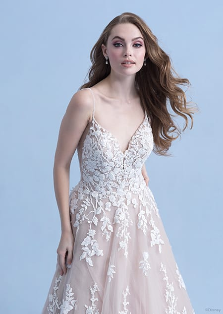 A woman wearing the Snow White wedding gown from the 2021 Disney Fairy Tale Weddings Collection