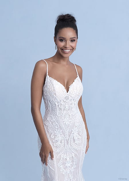A woman wearing the Tiana wedding gown from the 2021 Disney Fairy Tale Weddings Collection