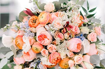 A bouquet featuring an assortment of roses and other flowers