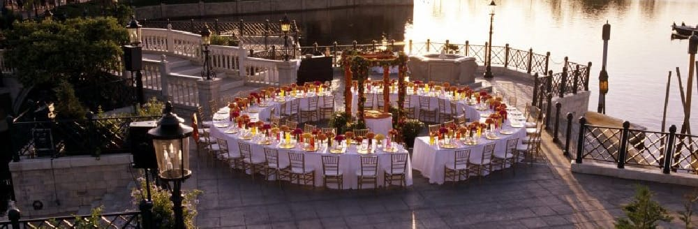 Tables arranged to make a giant circle in a courtyard next to World Showcase Lagoon