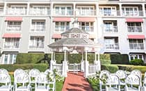 Two sections of a chairs face a gazebo in a hotel courtyard