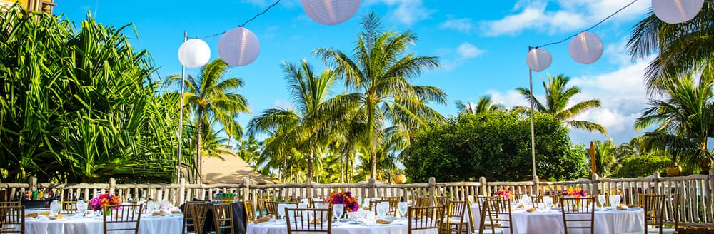 Lanterns hang from wires over a wedding reception