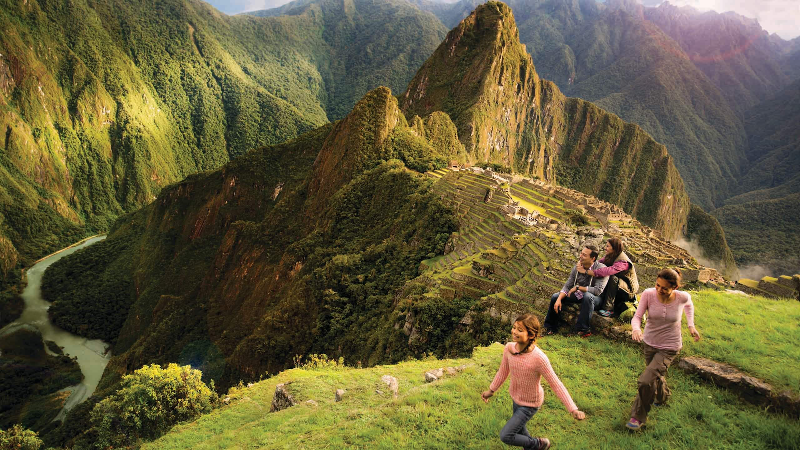 A family of 4 hiking in the mountains of Peru by Machu Picchu