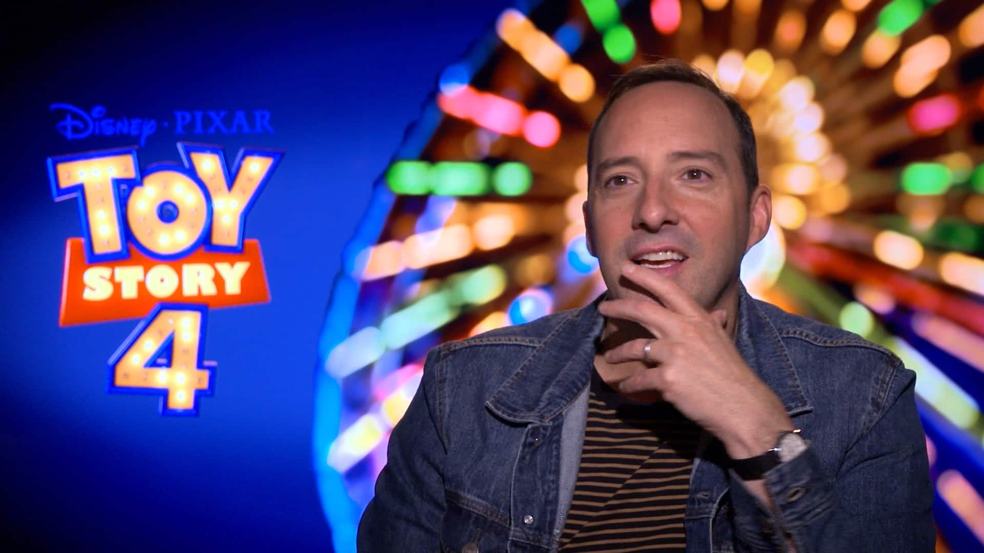 Actor Tony Hale sits in front of a promotional poster for Toy Story 4 Actor Tony Hale sits in front of a promotional poster for Toy Story 4