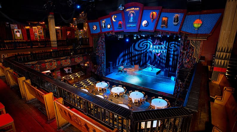 House of Blues stage area as seen from a balcony with benches and chairs