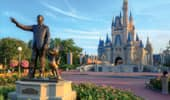 Statue of Walt Disney and Mickey Mouse in front of Cinderella's Castl