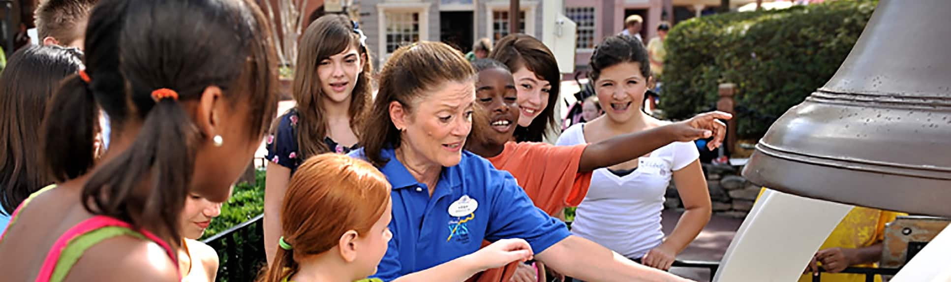 A Cast Member with smiling children