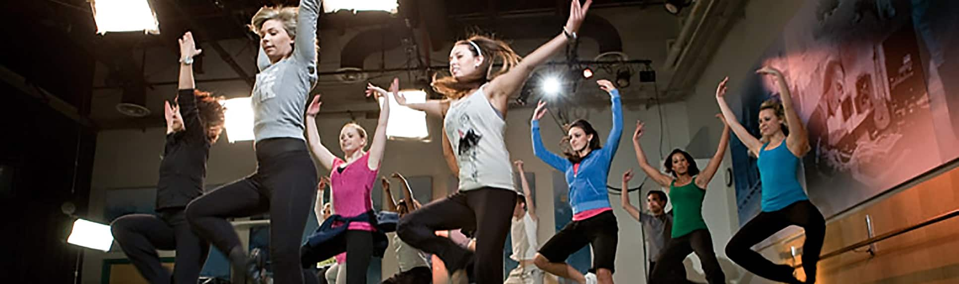 Dancers jumping in unison