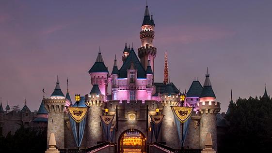 Sleeping Beauty Castle illuminated at night at Disneyland Park