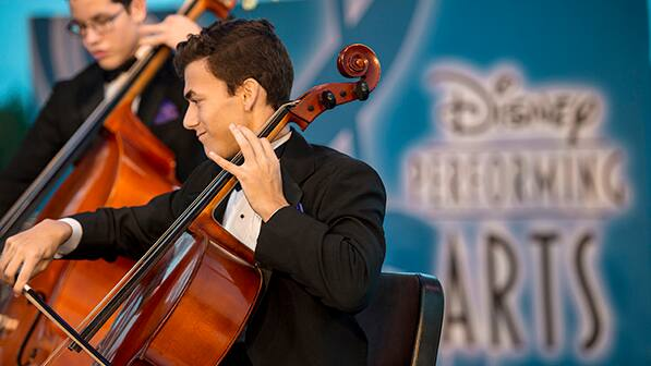 Young performers wearing tuxedos and playing bass instruments